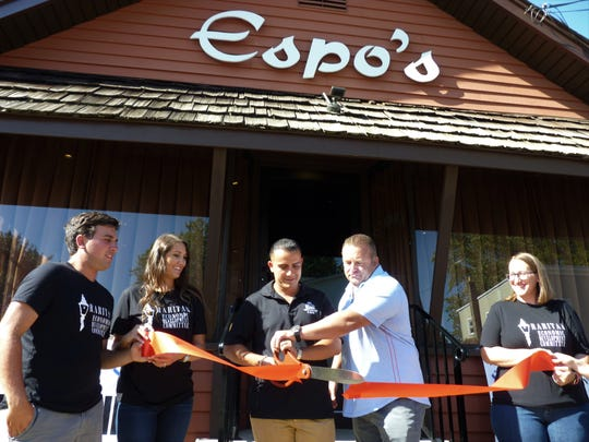 Nick Zamora, center, with his business partner, Kevin Sempervive, to his right, cuts the ribbon on Espo's Italian restaurant in Raritan during the restaurant's grand reopening on Thursday, Aug. 29, 2019.