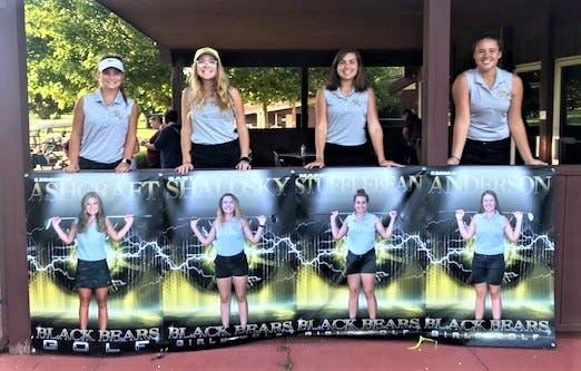 River View's four seniors (left to right) Lindsey Ashcraft, Kailyn Shalosky, Marie Stufflebean and Emma Anderson display their senior posters after the Lady Bears set a school record for nine holes with a 169 on Wednesday at Hickory Flats.