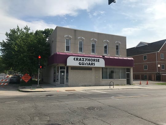 The former Crazyhorse Guitars at 2331 University Ave. will be restored to its original 1887 grandeur.