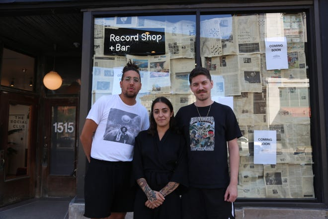 Andrey Douthard, left, Anna Atanassova  and Zach Poley photographed outside their soon-to-open record store/wine bar hybrid, Paramita Sound, in a street-level space at Detroit's Siren Hotel on August 29, 2019.