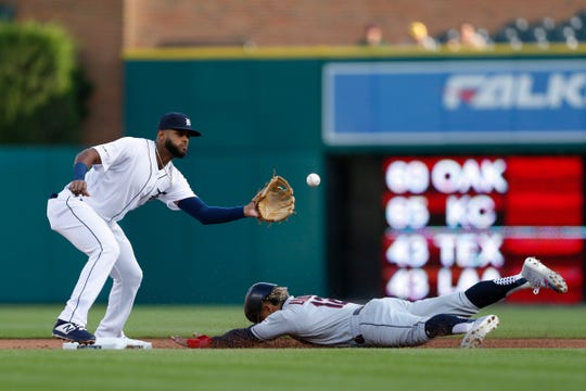 Cleveland Indians shortstop Francisco Lindor (12) slides safe into second base against Detroit Tigers shortstop Willi Castro (49) during the first inning at Comerica Park, Wednesday, Aug. 28, 2019, in Detroit.