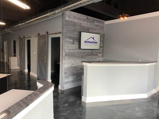 Barn doors, barn wood-clad walls and an open concept now greet guests and real estate brokers at JAG Real Estate Executives in Hazel Park.
