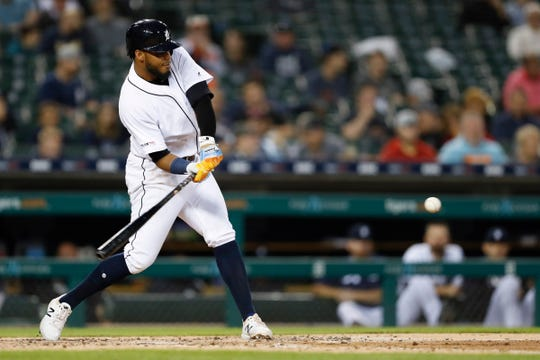 Detroit Tigers third baseman Dawel Lugo (18) hits a solo home run during the fifth inning against the Cleveland Indians at Comerica Park, Wednesday, Aug. 28, 2019, in Detroit.