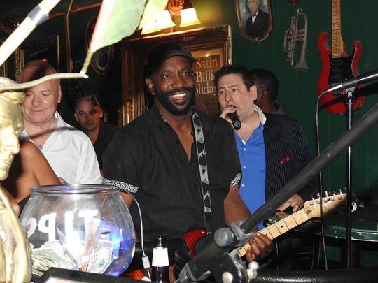 Thomas McClary, (center) founder of The Commodores with Detroit photographer, John Enot singing background.