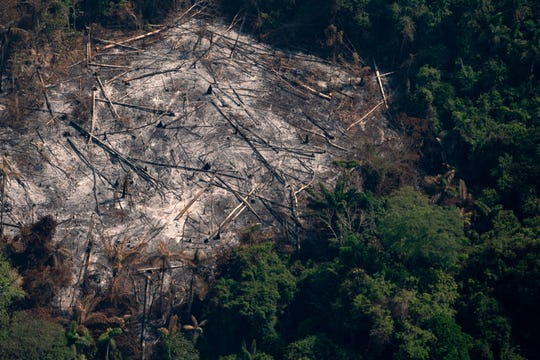 An area left scorched by fires is seen in the Menkragnoti indigenous reserve of the Kayapo indigenous group of Amazon rainforest in Altamira, Para state, Brazil, Wednesday, Aug. 28, 2019. Brazilian President Jair Bolsonaro said Wednesday that Latin America's Amazon countries will meet in September to discuss both protecting and developing the rainforest region, which has been hit by weeks of devastating fires.