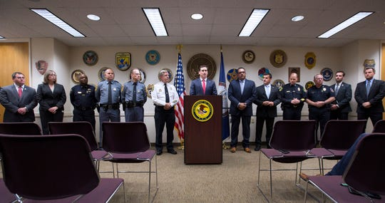 G. Zachary Terwilliger, U.S. Attorney, center, speaks during a press conference inside the United States Attorney's Office in Norfolk, Va., Thursday, Aug. 29, 2019. Law enforcement officials in Virginia say they've busted a multi-state drug ring and seized enough cheap fentanyl to kill 14 million people. The bust was announced Thursday in Norfolk by Terwilliger, the U.S. Attorney for the Eastern District of Virginia.