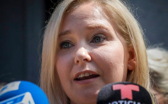 Virginia Roberts Giuffre, a sexual assault victim, speak during a press conference outside a Manhattan court where sexual victims, on invitation of a judge, addressed a hearing after the accused Jeffrey Epstein killed himself before facing sex trafficking charges, Tuesday Aug. 27, 2019, in New York.