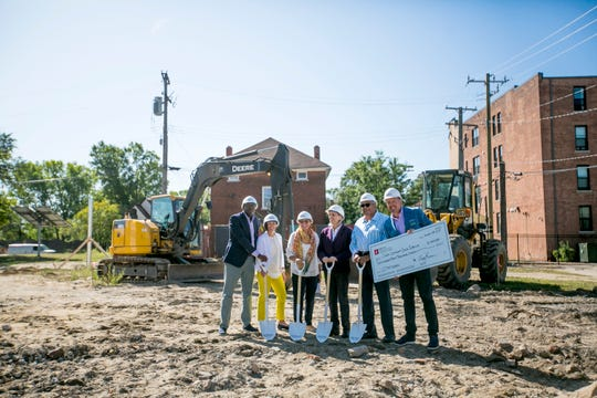 Epitec executives Anthony Hollaman, from left, Rebecca Bray and Josie Sheppard; Cass Community Social Services head Faith Fowler and Epitec CEO Jerry Sheppard and COO Mark Roma gather for the ceremonial groundbreaking Thursday.