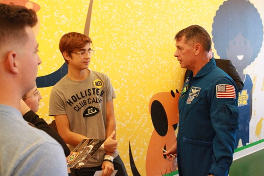 NASA astronaut Shane Kimbrough speaks with Bryan Finn, 17, of Allen Park on Thursday.