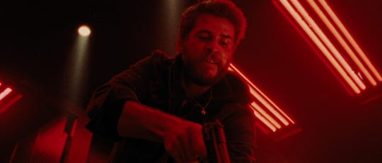 "Liam Hemsworth in ""Killerman."""