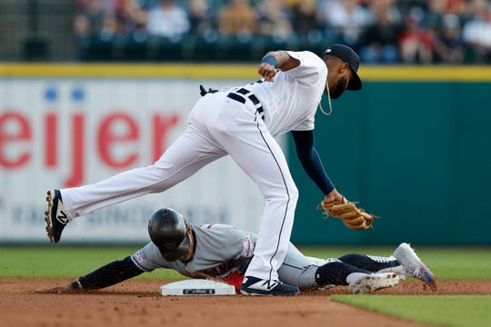 Cleveland Indians' Francisco Lindor slides under the tag of Tigers shortstop Willi Castro and safely steals second during the first inning on Wednesday.