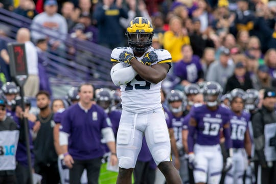 Michigan defensive lineman Kwity Paye will be charged with replacing some of the production left by Chase Winovich and Rashan Gary, who are now playing in the NFL.