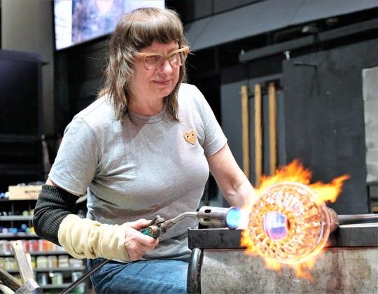 Deborah Czeresko, winner of the Netflix competition series Blown Away, demonstrates her glass blowing skills at the Corning Museum of Glass.