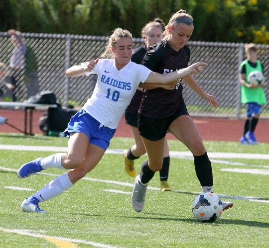 Miranda Novitsky (10) of Horseheads and Madison Ross of Elmira battle for possession during the Express' 2-1 victory in girls soccer Aug. 29, 2019 at Ernie Davis Academy in Elmira.