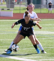 Elmira's Parker Moss, front, battles for position against Horseheads' Rachel Williams during the Express' 2-1 victory in girls soccer Aug. 29, 2019 at Ernie Davis Academy in Elmira.