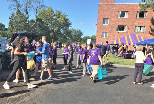 Elmira College student volunteers help members of the incoming freshman class unpack their belongings Thursday morning as part of the annual campus Move-In Day.