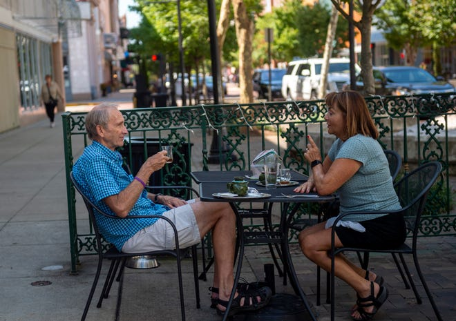 Michael Kearns, left, of Evansville enjoys tea with his friend Anita Doty of Newburgh at Arazu on Main in Evansville, Thursday afternoon, Aug. 29, 2019.