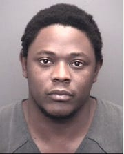 Julien Theodore Hinton, 26, is charged with armed robbery.