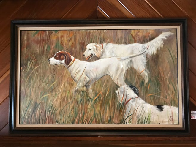 An iconic dog painting at the Kennel Club fetched more than $11,000 in an auction. The painting by Fred Eilers hung in the Kennel Club's library for decades.