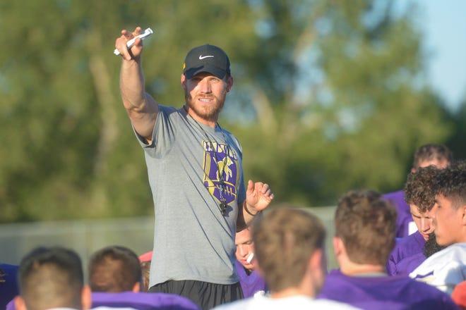 Fort Collins football coach Matt Yemm talks to his team after practice on Wednesday, Aug. 29, 2019.