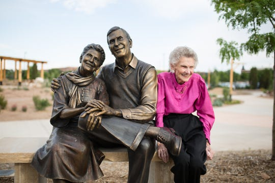 Joyce Everitt sits next to a bronze sculpture of herself and late husband, Bob, at the Gardens of Spring Creek, 2145 Centre Ave., Fort Collins.