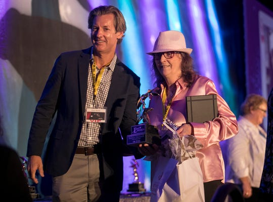 Veronica Martorelli of Bailey's General Store accepts her E Award for the other services/businesses category at the 2019 Elaine McLaughlin Outstanding Hospitality Service Awards Ceremony on Thursday, August 29, 2019, at the Westin Cape Coral Resort at Marina Village.