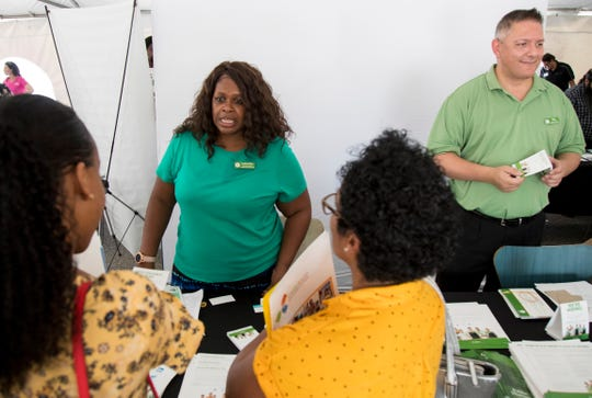 Latarsha Melvin, left, and Alex Blanco of Publix speak to job candidates at a job fair at the Dream Center on Thursday, August 29, 2019, in Fort Myers.