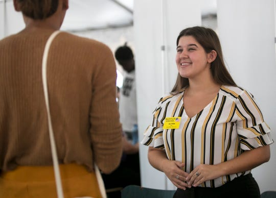 Allyssa Johnson of Waffle House talks to a job-seeker at a job fair on Thursday, August 29, 2019, at the Dream Center in Fort Myers.