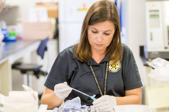 Serologist Ashleigh Dixon examines an undergarment in a sexual assault case at the Richland County Sheriff's Department DNA Lab.