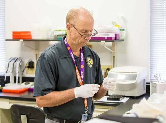 DNA analyst John Barron examines a DNA sample from a sexual assault case at the Richland County Sheriff's Department DNA Lab.