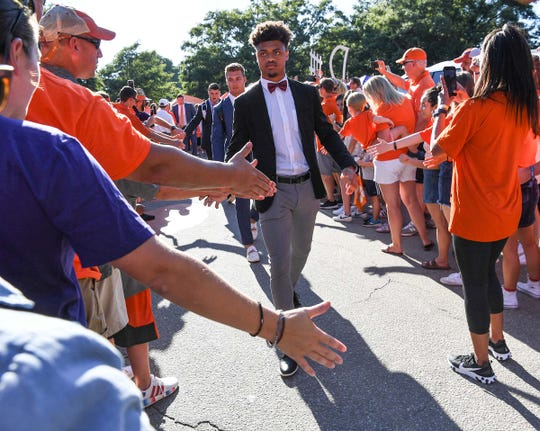Clemson defensive back A.J. Terrell (8) greets fans during Tiger Walk before kickoff outside Memorial Stadium in Clemson Thursday.