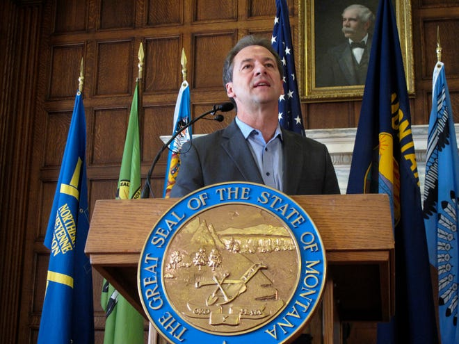 "FILE - In this June 8, 2018 file photo, Montana Gov. Steve Bullock speaks before signing an executive order requiring major state government contractors to disclose any contributions to so-called ""dark money"" groups that aren't required to disclose their donors under federal election laws at the Capitol in Helena.  A conservative advocacy group is challenging Bullock's executive order that requires organizations who receive state contracts to report political contributions that exceed $2,500, even if those disclosures aren't required under federal election laws. The federal court challenge was filed Tuesday, Aug. 27, 2019 by the Illinois Opportunity Group. (AP Photo/Matt Volz, File)"