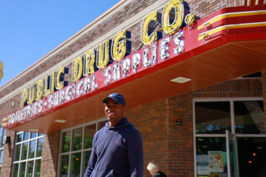 """Screenwriter Joshua Dowdy of """"Perfectly Timed"""" pictured outside of the Public Drug Co."""