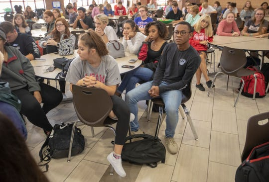 Students watch a talk about vaping by Gov. Eric Holcomb at Fishers High School on Aug. 29. Gov. Holcomb announced initiatives designed to stem the use of vaping and traditional tobacco products by children.