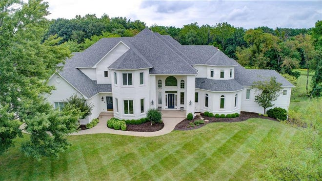 Jim Irsay's Zionsville home sits on 16 acres of property with a pond and a creek and is surrounded by woods.
