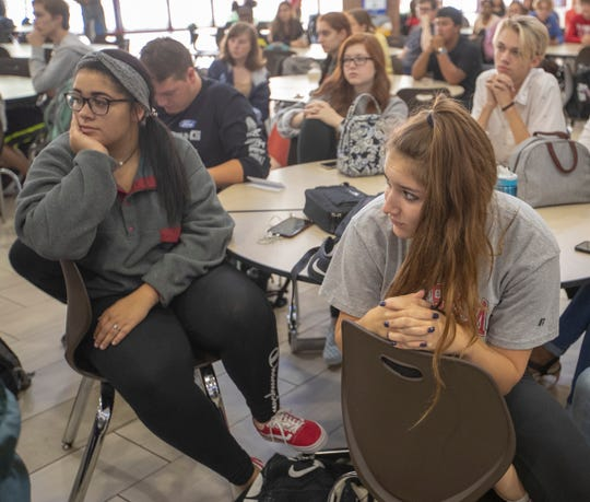 Students watch a talk about vaping by Gov. Eric Holcomb at, Fishers High School on Aug. 29, 2019.