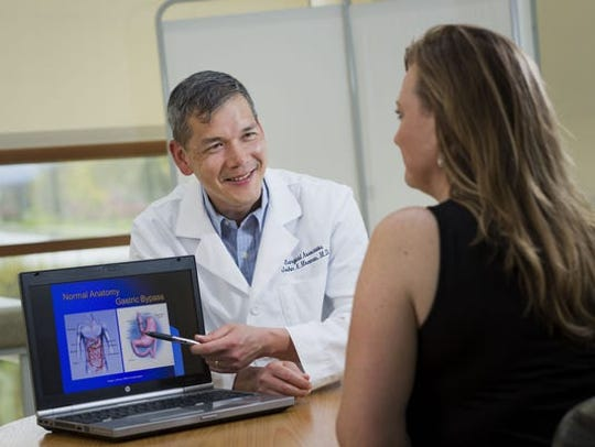 Dr. John Macenas with patient at CCHL