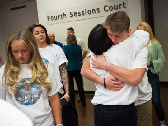 Friends of Zach Munday give hugs to Zach's mother Jeanne Munday, right, outside of Knox County Criminal Court on Thursday, August 29, 2019.