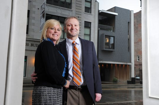 Buzz Nabers and his wife Trish pose in their building located at 304 S. Gay St. Tuesday, Nov. 15, 2011.  Dr. Nabers will open his dental practice on the first floor while the couple will live on the upper floors in their private residence.