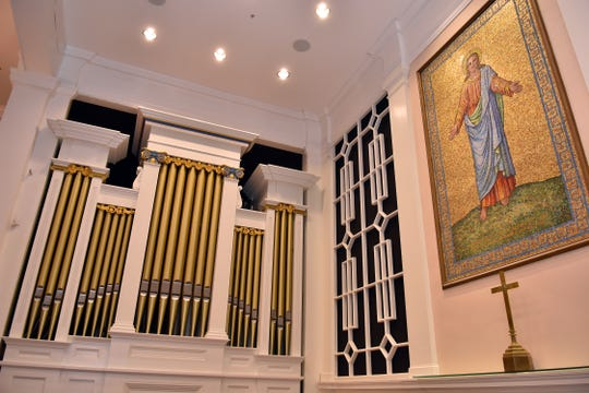 Organ pipes and a mosaic of Christ near the altar of First Presbyterian Church, August 27, 2019.