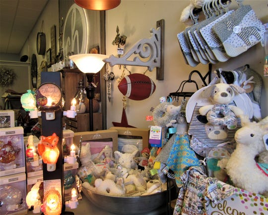 Gifts for baby include fanciful soft toys, blankets, nightlights and pacifiers.