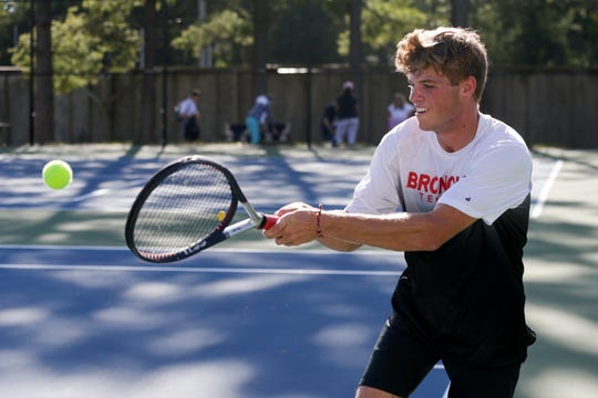 Lafayette Jeff's Luke Riley hits the ball during an IHSAA tennis match against Central Catholic's Sebastian Lux, Wednesday, Aug. 28, 2019 in Lafayette.