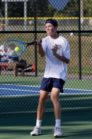 Central Catholic's Sebastian Lux hits the ball during an IHSAA tennis match against Lafayette Jeff's Luke Riley, Wednesday, Aug. 28, 2019 in Lafayette.