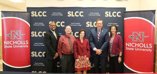 South Louisiana Community College and Nicholls State University have signed an articulation agreement to make transferring credits either. From left are Vincent June, SLCC vice chancellor for Academic and Student Affairs; John Wright, SLCC dean of Liberal Arts and Humanities; Natalie Harder, SLCC chancellor; Jay Clune, president of Nicholls State; and Jean Donegan, interim dean of Liberal Arts.