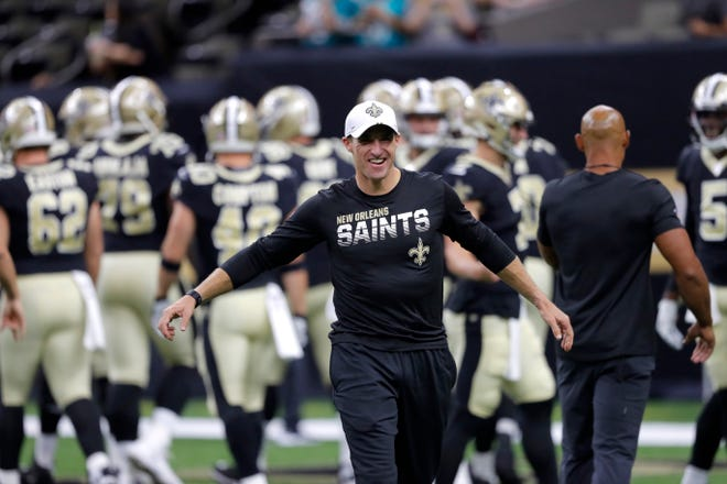 New Orleans Saints quarterback Drew Brees laughs on the field before an NFL preseason football game against the Miami Dolphins in New Orleans, Thursday, Aug. 29, 2019. (AP Photo/Bill Feig)