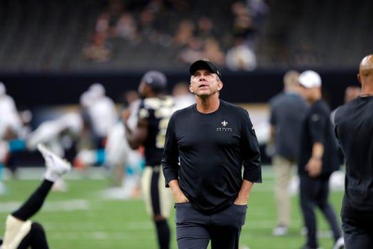 New Orleans Saints head coach Sean Payton walks on the field before an NFL preseason football game against the Miami Dolphins in New Orleans, Thursday, Aug. 29, 2019. (AP Photo/Bill Feig)
