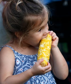 Brooklyn Dunn, 3, from Bexley, eats sweet corn Wednesday, Aug. 28, 2019, at the Millersport Sweet Corn Festival in Millersport.