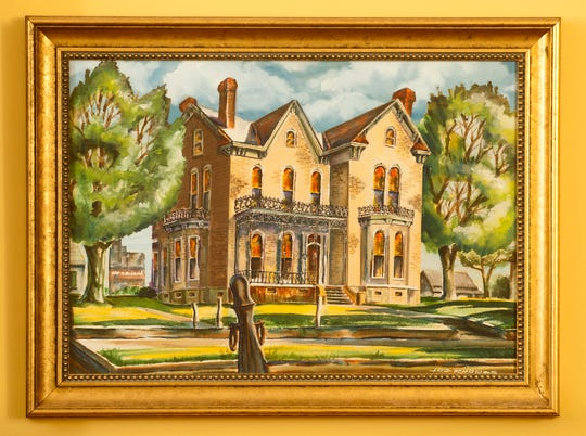 A painting of the home Jim Stein grew up in hangs in the living room. Aug. 19, 2019