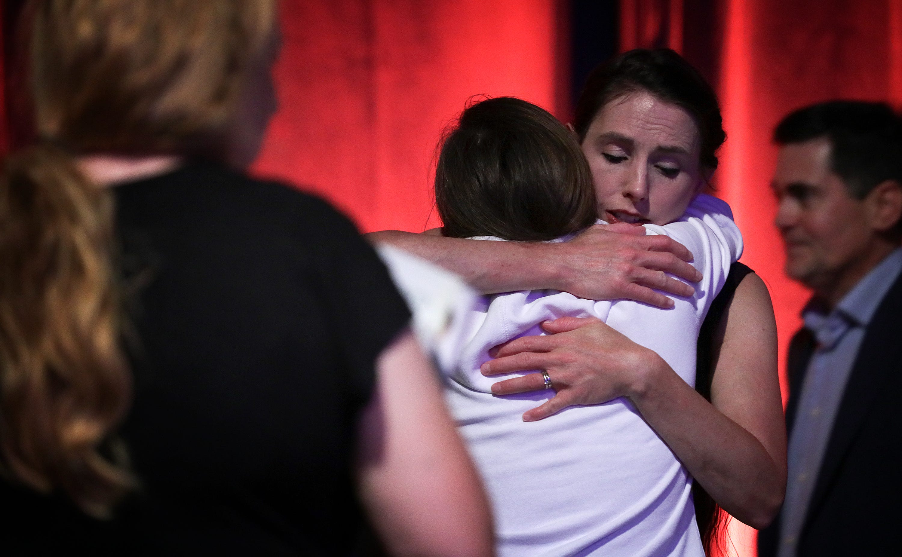 Rachael Denhollander hugs Madeline, an abuse survivor, after a panel discussion on abuse in the church the night before the Southern Baptist Convention opened in Birmingham, Alabama.