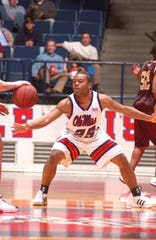 Louisville defensive coordinator gets into a defensive stance while playing point guard for Ole Miss. Brown was a two-sport athlete at Ole Miss.